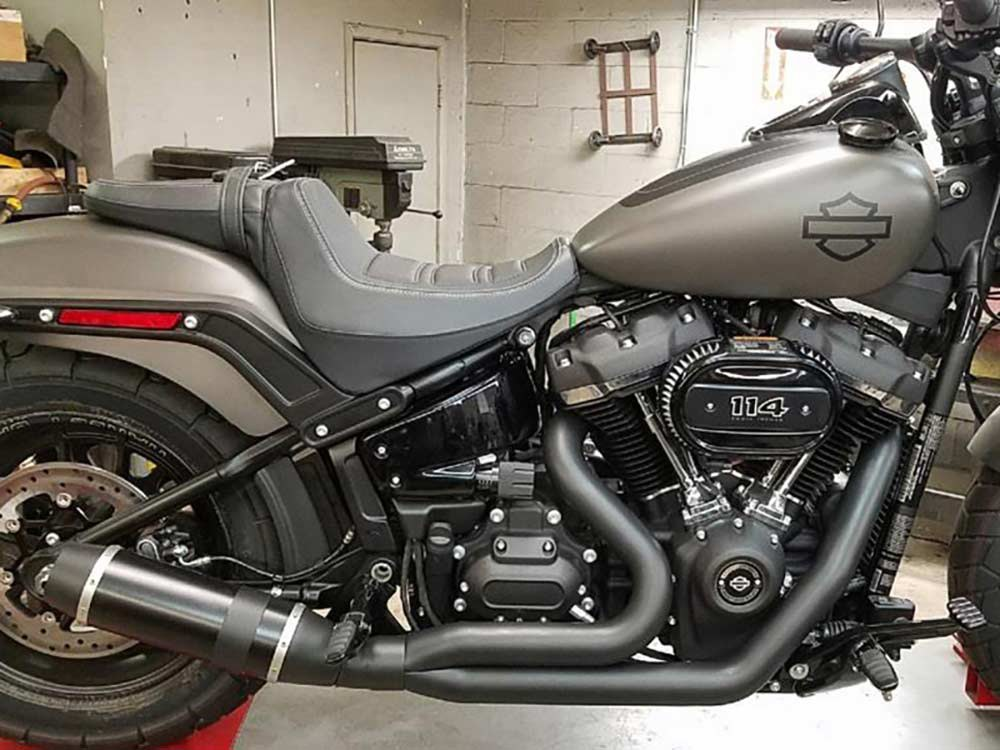 Bob Cat 2-into-1 Exhaust - Black with Black Satin Sleeve Muffler. Fits Softail 2018up.