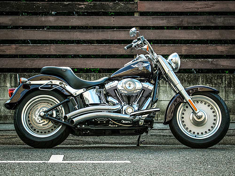 Sharp Curve Radius Exhaust with Chrome Finish & Chrome End Caps. Fits Softail 1986-2017.