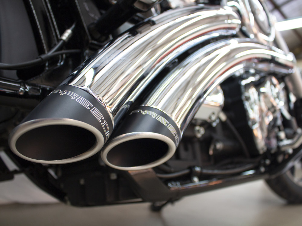 Radical Radius Exhaust with Chrome Finish & Black End Caps. Fits Softail 2018up.