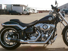 Bob Cat 2-into-1 Exhaust with Chrome Finish & Black Satin Sleeve Muffler. Fits Softail 2000-2017 & Rocker 2008-2011 Models.